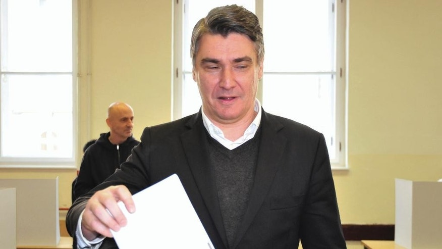 Croatia's  incumbent Prime Minister  Zoran Milanovic votes at a polling station in Zagreb, Croatia, Sunday, Nov. 8, 2015. Croatia's ruling center-left coalition faces a strong challenge from a conservative opposition in the Balkan country's first parliamentary election since joining the European Union in 2013. (AP Photo)
