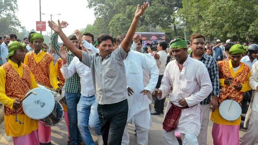 Supporters of an alliance of parties opposed to India's ruling Bharatiya Janata Party celebrate as early results of Bihar state elections indicate victory for them in Patna, India, Sunday, Nov. 8, 2015. Indian Prime Minister Narendra Modi's ruling Hindu nationalist party conceded defeat Sunday in a crucial election in one of India's most populous states.(AP Photo/Aftab Alam Siddiqui)