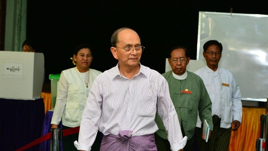 Myanmar's President Thein Sein leaves after casting his vote in Naypyitaw, Myanmar, Sunday, Nov. 8, 2015. Myanmar voted Sunday in historic elections that will test whether popular mandate will help loosen the military's longstanding hold on power even if opposition leader Aung San Suu Kyi's party secures a widely-expected victory. (AP Photo/Aung Shine Oo)