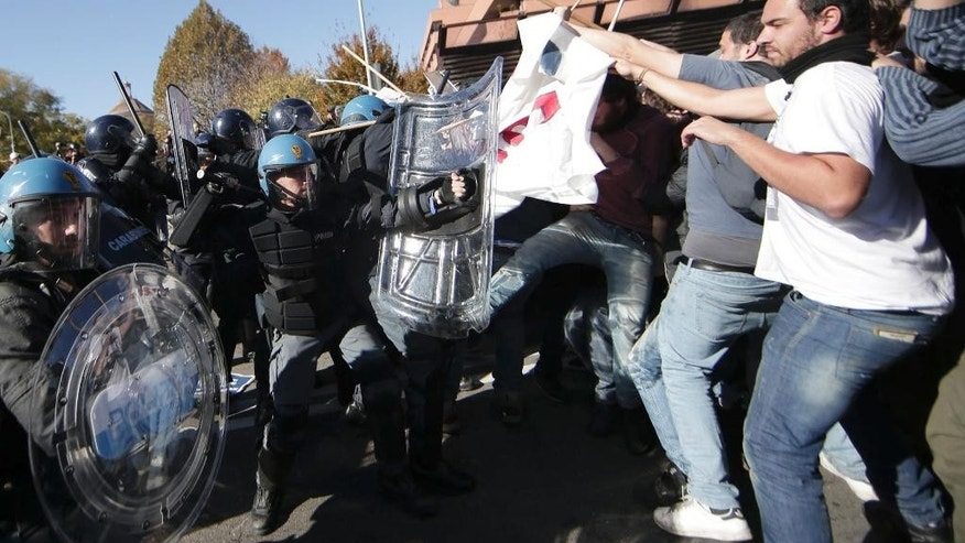 Riot police and protesters clash in Bologna, Italy, Sunday, Nov. 8, 2015. Hundreds of demonstrators gathered in Bologna to protest the arrival of Northern League leader Matteo Salvini, whom they decried as a racist for his anti-migrant views, and his meeting with former premier Silvio Berlusconi. (Massimo Percossi/AP via ANSA) ITALY OUT