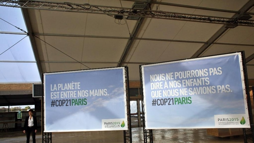 "Boards reading ""The planet is in our hands"", left, and ""We cannot say to our children that we did not know"" are pictured in the site of the COP21, Paris Climate Conference in Le Bourget, north of Paris, France, Sunday, Nov. 8, 2015. Some 80 heads of state including President Barack Obama, and tens of thousands of other people, are expected in Paris for the conference opening. (AP Photo/Thibault Camus)"