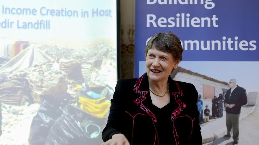 "The head of the U.N. Development Program, Helen Clark, speaks during her visit to the Al-Akedir landfill, near the Syrian border, during a tour of northern Jordan on Sunday, Nov. 8, 2015. Clark says she is ""beating the drum"" for a new deal for Syrian refugees that will help them make a living close to home. (AP Photo/Raad Adayleh)"