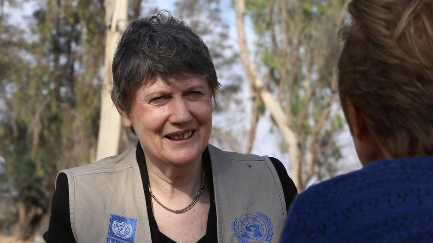 "The head of the U.N. Development Program, Helen Clark, speaks to The Associated Press during her visit to the Al-Akedir landfill, near the Syrian border, during a tour of northern Jordan on Sunday, Nov. 8, 2015. Clark says she is ""beating the drum"" for a new deal for Syrian refugees that will help them make a living close to home. (AP Photo/Raad Adayleh)"