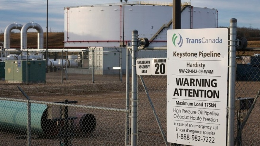 TransCanada's Keystone pipeline facilities in Hardisty, Alberta, Canada, on Friday, Nov. 6, 2015.  Following the Obama administrations rejection of the Keystone XL pipeline, the oil industry faces the tricky task of making sure the crude oil targeted for the pipeline still gets where it needs to go.  (Jeff McIntosh/The Canadian Press via AP) MANDATORY CREDIT