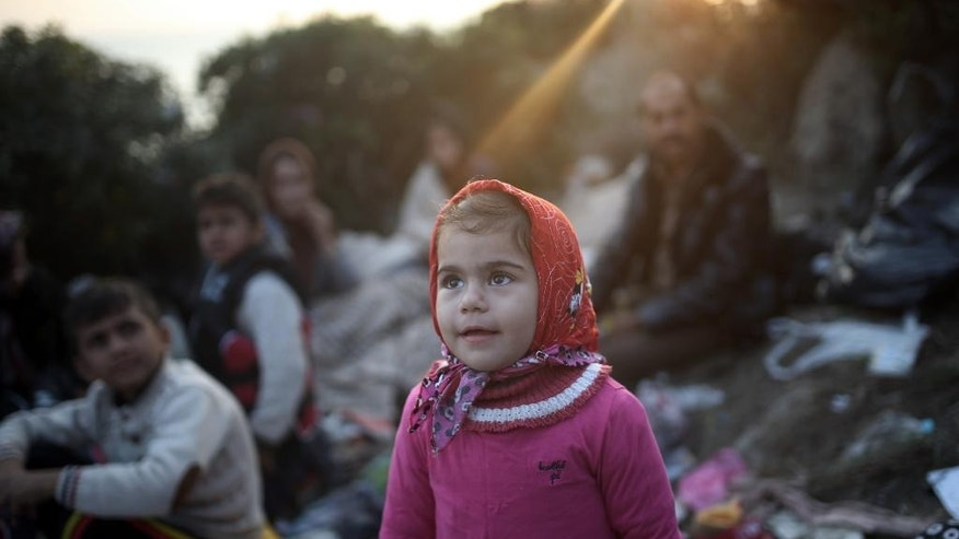 In this late Saturday, Nov. 7, 2015 photo made available Sunday, migrants wait to travel by dinghies to the Greek islands from Turkish coast near Bodrum, Turkey. More than 300,000 people have traveled on boats from nearby Turkey to Greek islands this year, with uncounted numbers dying along the way. (AP Photo/Emre Tazegul)