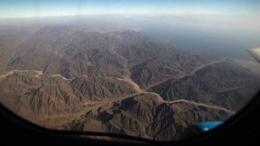 The mountains of south Sinai are viewed from the window during a flight to Cairo from Sharm el-Sheik, Egypt, Monday, Nov. 9, 2015. Russian news agencies are quoting Dmitry Gorin, vice president of the Russian Travel Agencies Association, as saying the number of Russian tourists brought home from Egypt is likely to reach 23,000 by mid-day. Their returns come after last week's announcement that Russia was suspending new passenger flights to Egypt because of security concerns in the aftermath of the Oct. 31 plane crash. (AP Photo/Thomas Hartwell)
