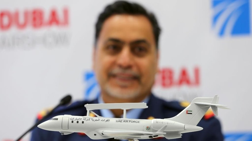 UAE Major General Abdullah Al Hashimi looks at a model of the Bombardier Global 6000 aircraft during the second day of the Dubai Airshow in Dubai, United Arab Emirates, Monday, Nov. 9, 2015. The United Arab Emirates' Ministry of Defense announced on Monday a $1.27 billion deal for upgraded Saab surveillance systems on Bombardier aircraft. (AP Photo/Kamran Jebreili)