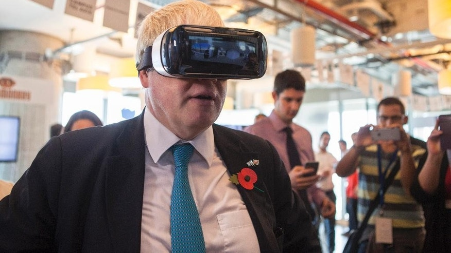 Mayor of London Boris Johnson wears virtual reality goggles during a visit to the Google offices in Tel Aviv, Israel, Monday, Nov. 9, 2015. (AP Photo/Dan Balilty)