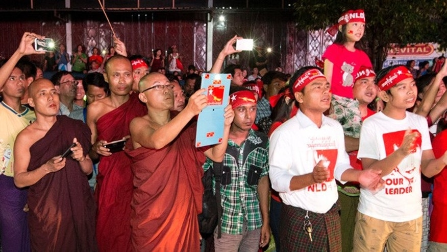 Nov. 9, 2015: Buddhist monks join supporters of Myanmar's National League for Democracy party as they wait for election results to be posted outside the NLD headquarters in Yangon, Myanmar.