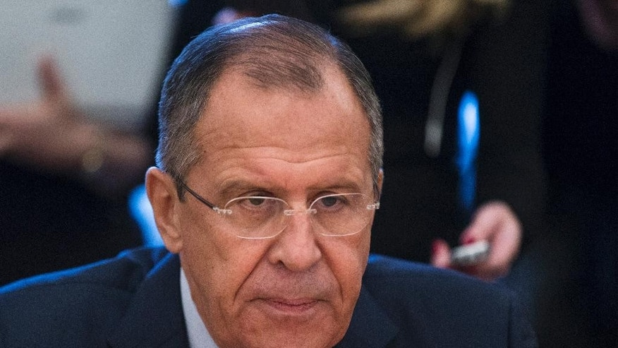 "FILE - In this Thursday, Nov. 5, 2015 file photo, Russian Foreign Minister Sergey Lavrov attends a meeting with U.N. Under-Secretary-General and Emergency Relief Coordinator Stephen O'Brien in Moscow, Russia. Russia's foreign minister said Monday Nov. 9, 2015, the next round of Syria talks expected to be held this weekend must not focus squarely on demands for Syrian President Bashar Assad's resignation, which he called a ""simplistic approach."" The talks should focus instead on reaching consensus on who should represent the Syrian opposition and who should be considered extremists. (AP Photo/Pavel Golovkin, File)"