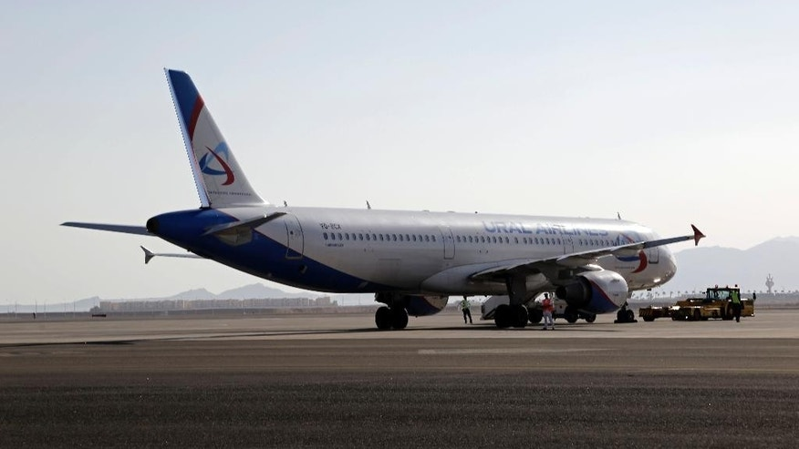 A Ural Airlines plane is parked on the tarmac at Sharm el-Sheikh Airport, south Sinai, Egypt, Monday, Nov. 9, 2015. Russian news agencies are quoting Dmitry Gorin, vice president of the Russian Travel Agencies Association, as saying the number of Russian tourists brought home from Egypt is likely to reach 23,000 by mid-day. Their returns come after last week's announcement that Russia was suspending new passenger flights to Egypt because of security concerns in the aftermath of the Oct. 31 plane crash. (AP Photo/Thomas Hartwell)