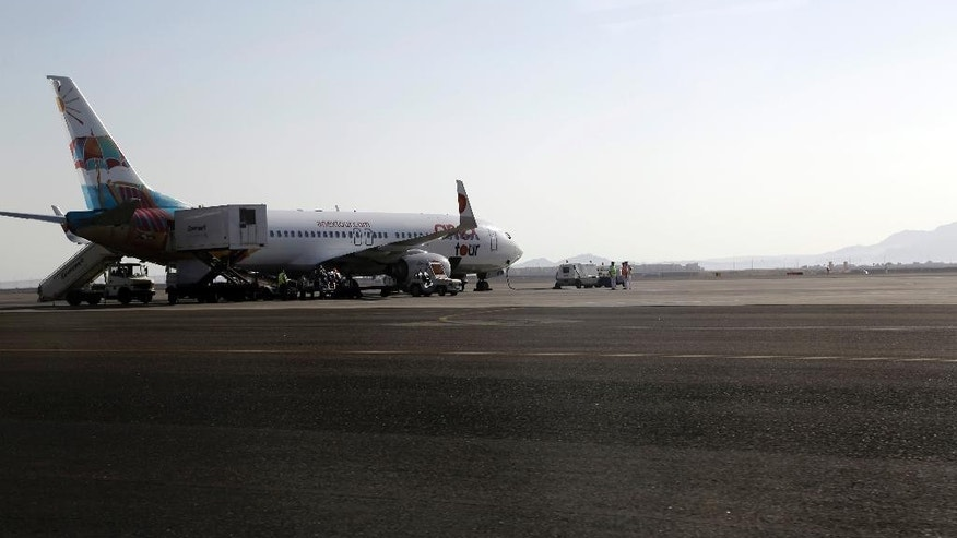 A plane from Anextours company is parked on the tarmac at Sharm el-Sheikh Airport, south Sinai, Egypt, Monday, Nov. 9, 2015. Russian news agencies are quoting Dmitry Gorin, vice president of the Russian Travel Agencies Association, as saying the number of Russian tourists brought home from Egypt is likely to reach 23,000 by mid-day. Their returns come after last week's announcement that Russia was suspending new passenger flights to Egypt because of security concerns in the aftermath of the Oct. 31 plane crash. (AP Photo/Thomas Hartwell)