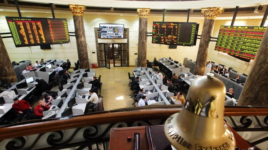 FILE -- In this Saturday, March 10, 2013 file photo, Egyptian traders work on the floor of the stock market in Cairo, Egypt. Egypt's benchmark stock index plunged 4.4 percent on Tuesday, Nov. 10, 2015, after steadily declining since Russia suspended flights to Egypt following the Oct. 31 Russian plane crash in the Sinai Peninsula. Russia  suspended all flights to Egypt ast Friday amid airport security concerns — a move that threatened to further devastate the Egyptian tourism industry, already suffering after years of political turmoil. (AP Photo/Amr Nabil, File)