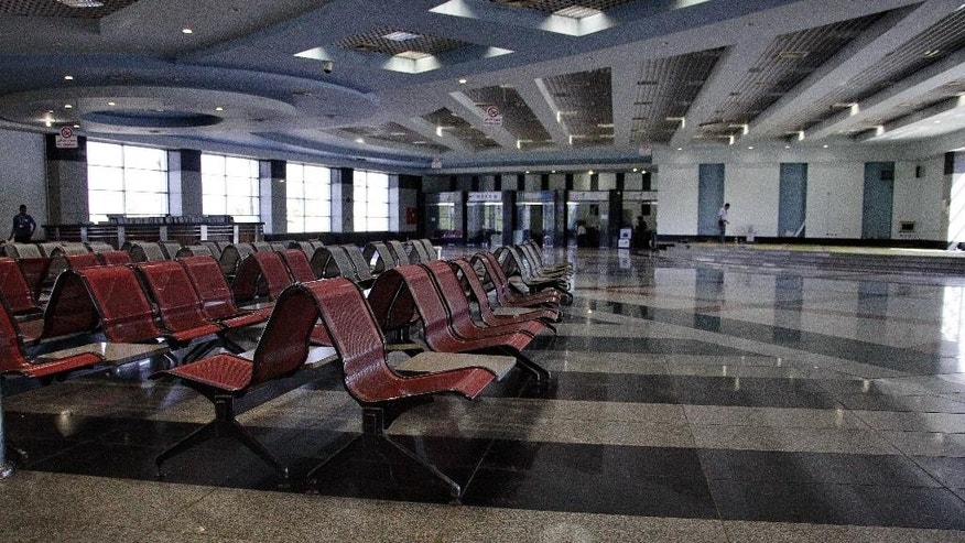 FILE -- In this Monday, Nov. 9, 2015 file photo, the arrival hall is empty at the Sharm el-Sheikh Airport in south Sinai, Egypt. Egypt's benchmark stock index plunged 4.4 percent on Tuesday, Nov. 10, 2015, after steadily declining since Russia suspended flights to Egypt following the Oct. 31 Russian plane crash in the Sinai Peninsula. Russia  suspended all flights to Egypt ast Friday amid airport security concerns — a move that threatened to further devastate the Egyptian tourism industry, already suffering after years of political turmoil. (AP Photo/Ahmed Abd El-Latif, File)
