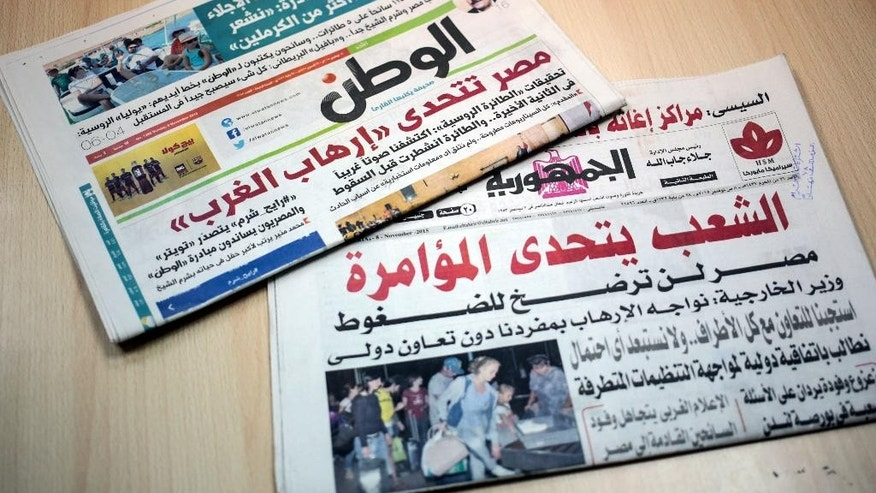 Two Egyptian daily newspapers from display headlines touting Western conspiracy theories.
