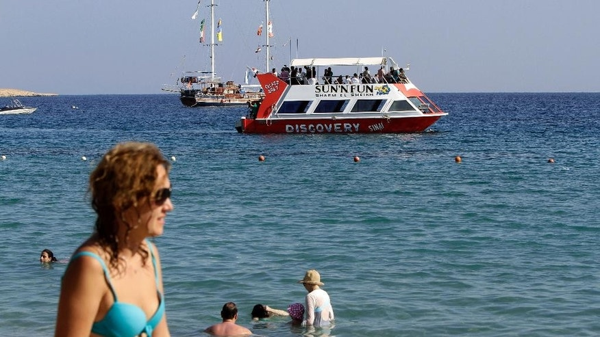 Tourists enjoy the Red Sea in Naama Bay, Sharm el-Sheikh.