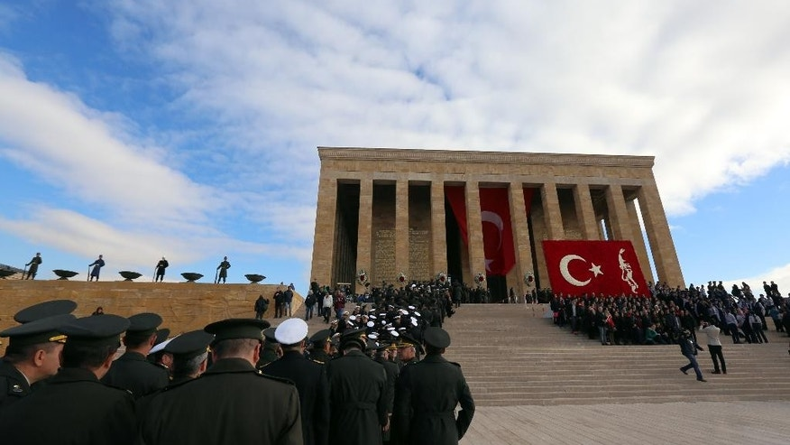 Turkish army officers walk to his mausoleum to remember the nation's founding father Mustafa Kemal Ataturk on the 77th anniversary of his death, in Ankara, Turkey, Tuesday, Nov. 10, 2015.(AP Photo/Burhan Ozbilici)