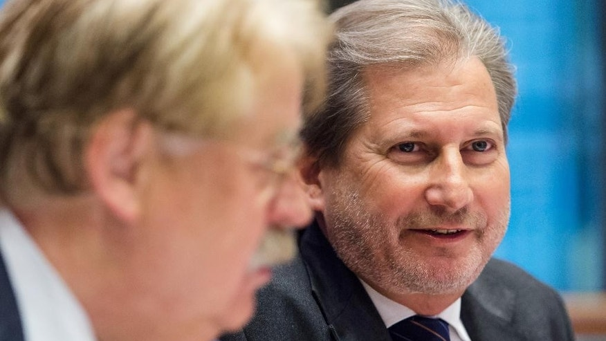 EU Commissioner for European Neighborhood Policy & Enlargement Negotiations Johannes Hahn, right, sits next to the Chair of the Committee on Foreign Affairs,  Elmar Brok, as he addresses the Committee at the European Parliament in Brussels on Tuesday, Nov. 10, 2015. (AP Photo/Geert Vanden Wijngaert)