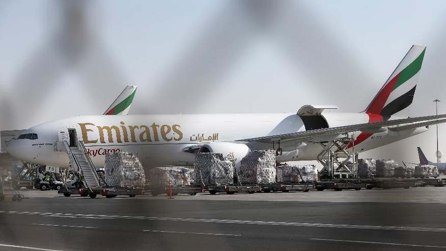An Emirates Airline cargo plane loads goods at the Al Maktoum International Airport in Dubai, United Arab Emirates, Monday, Nov. 9, 2015. Emirates, the Mideast's top airline, has expanded its cargo operation out to Dubai's new airport as it looks toward the future. (AP Photo/Kamran Jebreili)