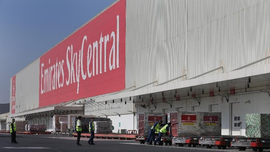 Emirates SkyCentral employees upload goods at their facilities of the Al Maktoum International Airport in Dubai, United Arab Emirates, Monday, Nov. 9, 2015. Emirates, the Mideast's top airline, has expanded its cargo operation out to Dubai's new airport as it looks toward the future. (AP Photo/Kamran Jebreili)