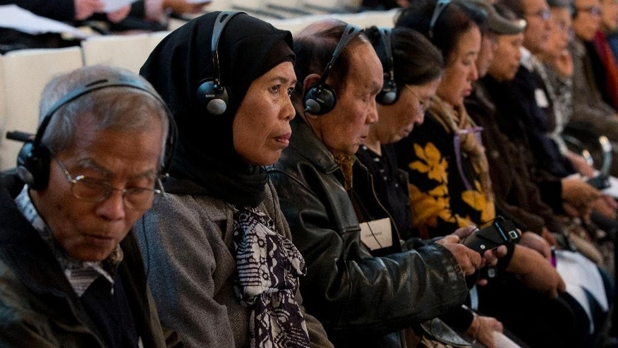 People attend the International People's Tribunal 1965 which opened hearings intended to publicize allegations of mass killings 50 years ago by Indonesian authorities of hundreds of thousands of suspected Communists, at the Nieuwe Kerk, or New Church, in The Hague, Netherlands, Tuesday, Nov. 10, 2015. The court has no formal legal powers, but aims to shed light on what organizers call the darkest days in Indonesia's post-colonial history and promote reconciliation by exposing the truth about the 1965 killings. (AP Photo/Peter Dejong)
