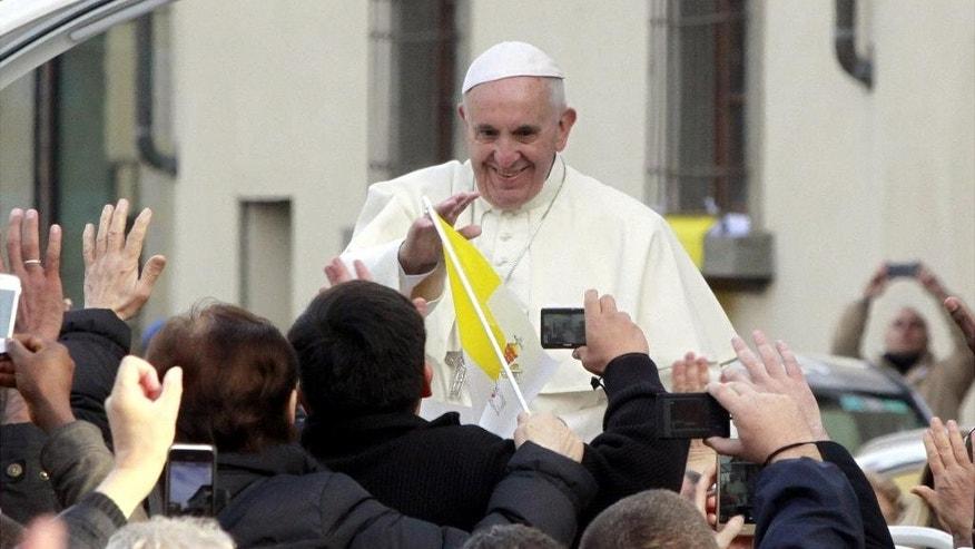 "Pope Francis waves to the crowd from his popemobile, in Prato, Italy, Tuesday, Nov. 10, 2015. The pope denounced the ""cancer"" of abusive labor practices during a visit Tuesday to the Italian industrial city of Prato, near Florence, where a 2013 garment factory fire killed seven Chinese workers. (AP Photo/Francesco Bellini)"