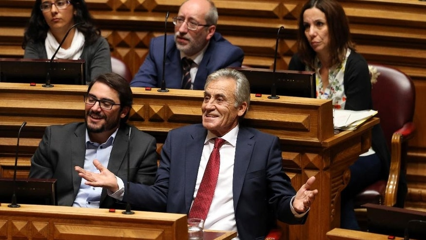 Portuguese Communist Party leader Jeronimo de Sousa, center, gestures during the debate of the government's four-year policy program at the Parliament in Lisbon, Monday, Nov. 9 2015. Together the left-of-center parties have 122 seats in the 230-seat Parliament, outnumbering the government, and have vowed to reject the program in a vote expected Tuesday. Such a defeat would force the government, which took office on Oct. 30, to resign, possibly opening the door for the unprecedented leftist alliance, that includes the Communists, to take over. (AP Photo/Armando Franca)