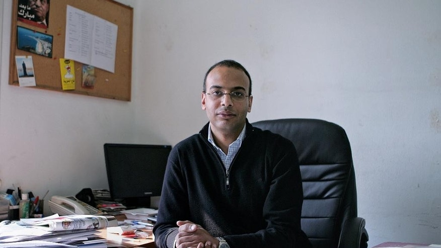 "This Dec. 7, 2011 photo, shows Hossam Bahgat in his office at the Egyptian Initiative for Personal Rights in Garden City, Cairo, Egypt. Lawyers for Bahgat, a leading Egyptian investigative journalist and human rights advocate said Monday, Nov. 9, 2015 that the Egyptian military is holding him in an undisclosed location while he faces charges of spreading ""false news."" Bahgat was detained Sunday after being summoned to an intelligence building in Cairo. (AP Sarah Rafea via AP) MANDATORY CREDIT"