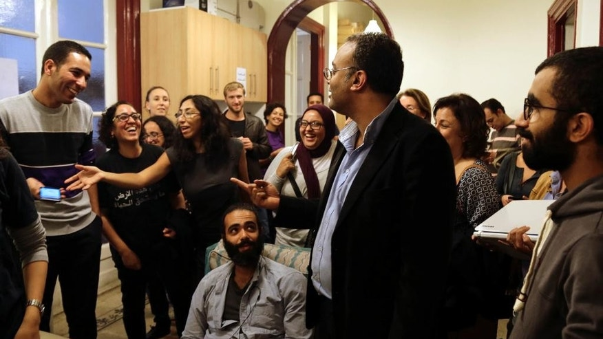"Hossam Bahgat, center right, celebrates his release with friends, colleagues and journalists at the office of the Egyptian Initiative for Personal Right, a human rights organization he founded in 2002, in Cairo, Egypt, Tuesday, Nov. 10, 2015. Egypt's military released Bahgat, a leading investigative journalist and human rights advocate, who had been detained under accusations of spreading ""false news."" No further information was available over whether charges still stand against Bahgat in the immediate moments after his release. (AP Photo/Ibrahim Ezzat)"