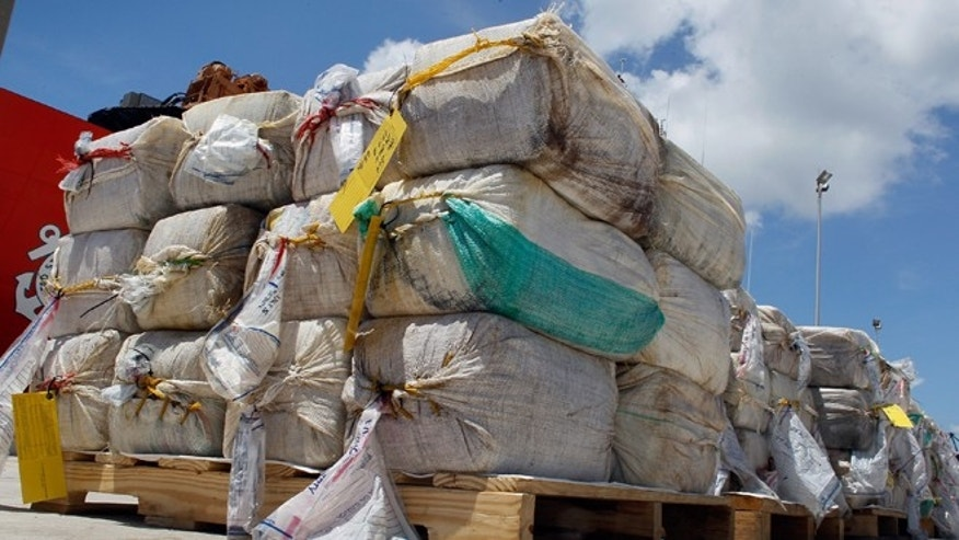 MIAMI BEACH, FL - AUGUST 02: Some of the 15,000 pounds of cocaine that  U.S. Coast Guard crew members offloaded from the Cutter Oak are seen next to the ship on August 2, 2011 in Miami Beach, Florida. The cocaine worth more than $180 million was  seized from a self-propelled semi-submersible vessel in the western Caribbean Sea on July 13.  (Photo by Joe Raedle/Getty Images)