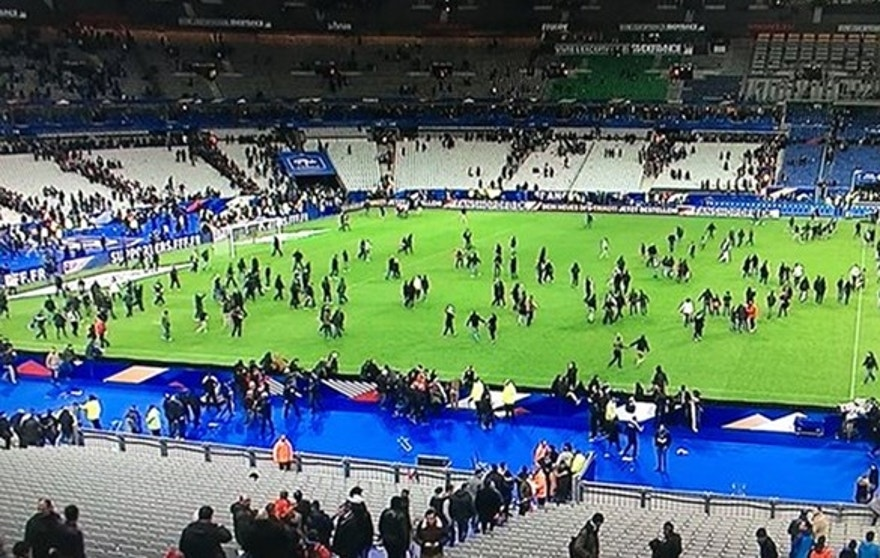 The soccer stadium where a match between France and Germany was going on as the attack began is shown.