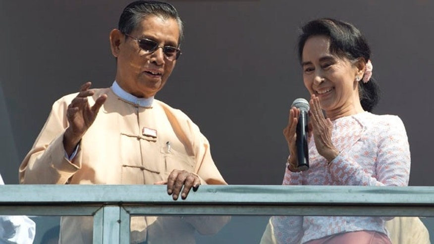 Nov. 9, 2015: Aung San Suu Kyi, the leader of Burma's National League for Democracy party, delivers a speech with party patron Tin Oo from a balcony of her party's headquarters in Yangon. (AP Photo/Mark Baker)