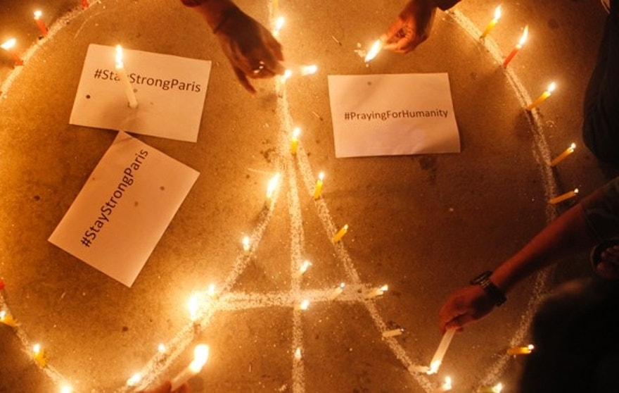 Nepalese people light candles for the victims of Paris terror attacks in Kathmandu.