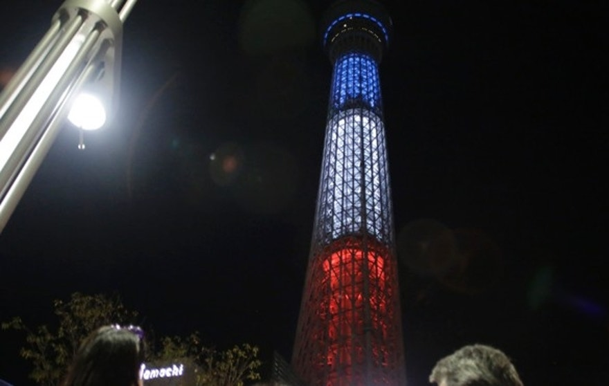 The Tokyo Skytree, the tallest tower in Japan,  is illuminated with the colors of the French tricolor.