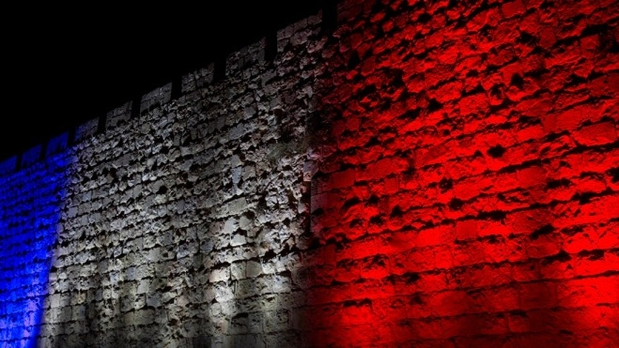 Jerusalem's Old City walls are illuminated with the colors of the French national flag in solidarity with France.