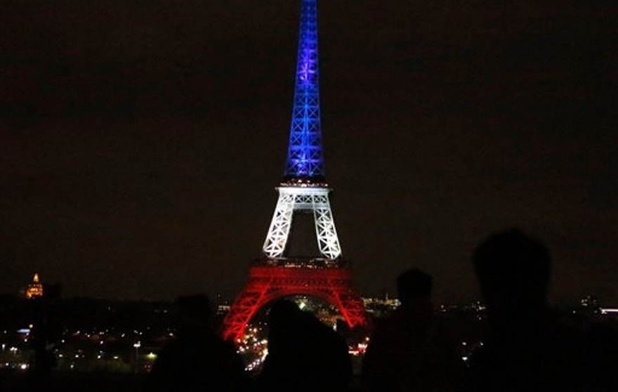 The Eiffel Tower lit up in the French national colors Monday.