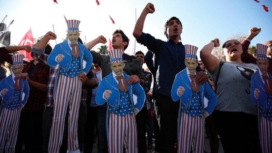 Nov. 15, 2015: Members of Turkey Youth Union hold effigies of U.S. President Barack Obama during a protest in Antalya, Turkey.