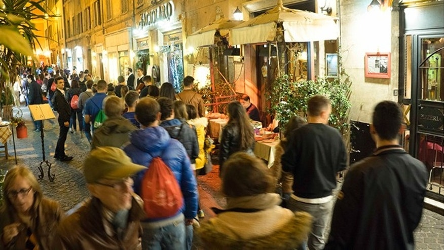 Nov. 13, 2015: People walk in Via del Pastino, in Rome. Along Rome's narrow Via dei Pastini, a street thronging with tourists in search of quaint restaurants, three trattorias, were raided this year as alleged fronts for money-laundering operations for the `ndrangheta.