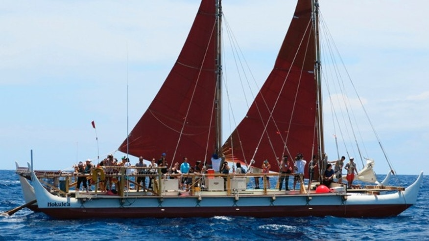 April 29: The Hokulea sailing canoe is seen off Honolulu. The Polynesian voyaging canoe, guided solely by nature on a three-year circumnavigation of the globe has reached its halfway point.