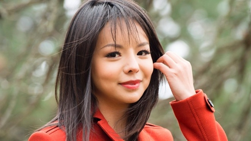 Nov. 13, 2015: Anastasia Lin, Canada's Miss World contestant, poses for a photograph in Toronto. Lin believes China is preventing her from getting a visa to attend the Miss World pageant because of her human rights comments about the communist country.