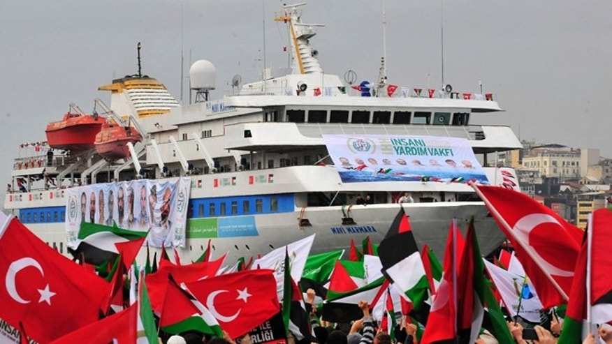 Dec. 26, 2010: Pro-Palestinian activists wave Turkish and Palestinian flags during the welcoming ceremony for cruise liner Mavi Marmara at the Sarayburnu port of Istanbul.