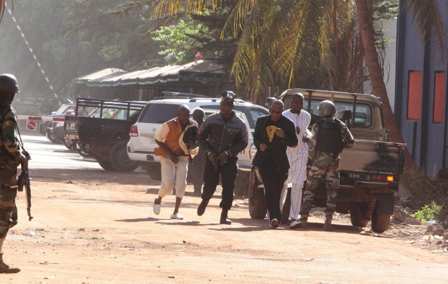 Nov. 20, 2015: People run to flee from the Radisson Blu Hotel in Bamako, Mali.