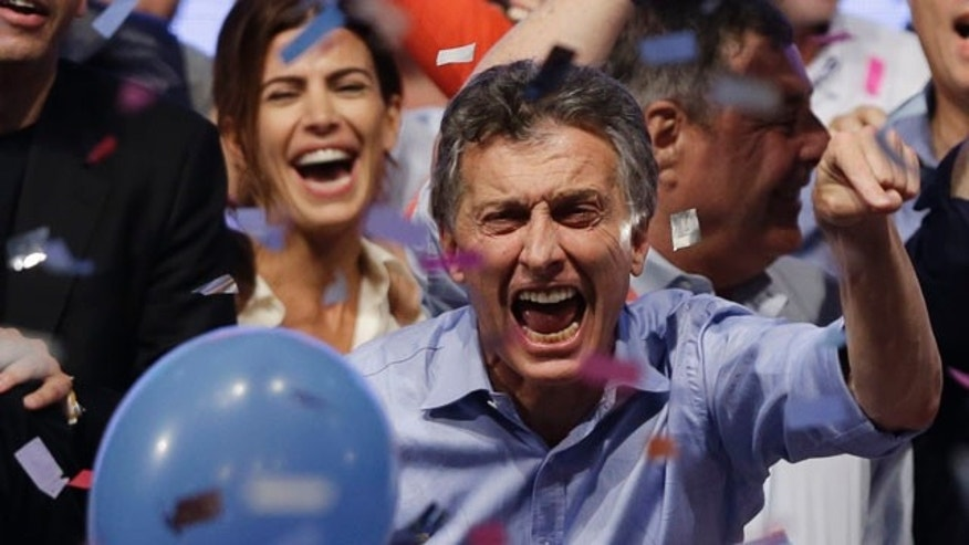 Nov. 22, 2015: Opposition presidential candidate Mauricio Macri and his wife Juliana Awada, back left, celebrate after winning Argetina's runoff presidential election in Buenos Aires. (AP Photo/Ricardo Mazalan)