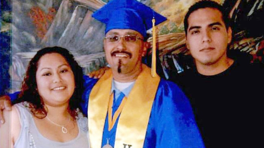 Luis Vargas with daughter Crystal and son Daniel at his community college graduation ceremony held within the walls of a California state prison in Blythe, Calif.