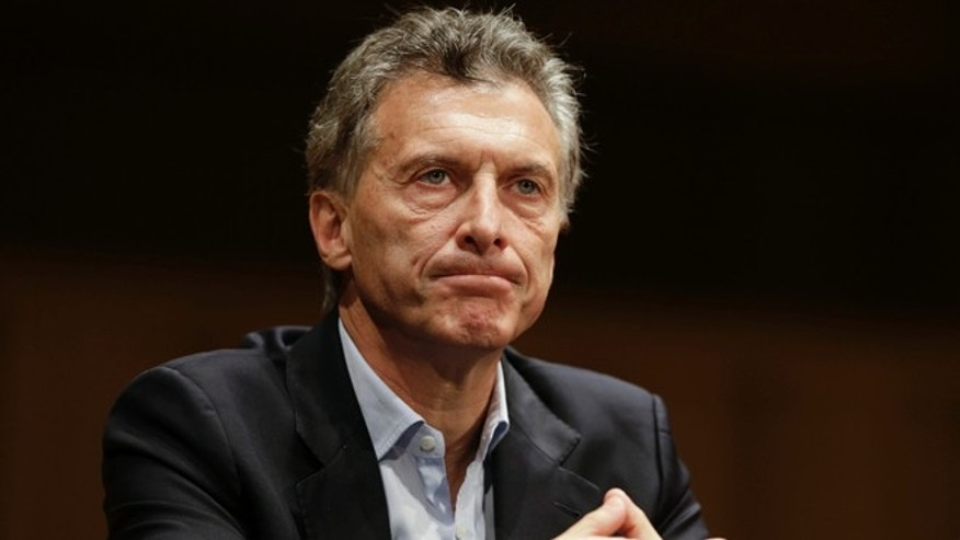 Argentina's President elect Mauricio Macri listens to a question during a press conference in  Buenos Aires, Argentina, Monday, Nov. 23, 2015. Macri won Argentina's runoff election against ruling party candidate Daniel Scioli, putting an end to the era of President Cristina Fernandez, who along with her late husband dominated the country's politics for 12 years. (AP Photo/Ricardo Mazalan)
