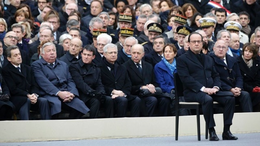 Nov. 27, 2015: French President Francois Hollande, right, attends a ceremony to honor the 130 victims killed in the Nov. 13 attacks, in the courtyard of the Invalides in Paris. (Philippe Wojazer/Pool Photo via AP)