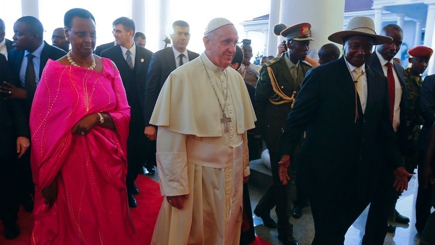 Nov. 27, 2015: Pope Francis meets with Uganda's President Yoweri Kaguta Museveni, right, and his wife Janet at the State House, in Entebbe, Uganda.