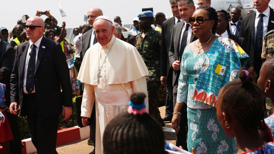 Pope Francis arrives in Bangui, Central African Republic, on the third leg of his trip to Africa Sunday Nov. 29, 2015. The Pope has landed in the capital of Central African Republic, his final stop in Africa and where he will seek to heal a country wracked by conflict between Muslims and Christians. (AP Photo/Jerome Delay)