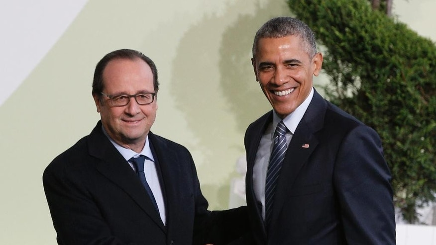 French President Francois Hollande, left, greets U.S. President Barack Obama as he arrives for the COP21, United Nations Climate Change Conference, in Le Bourget, outside Paris, Monday, Nov. 30, 2015. (AP Photo/Christophe Ena, Pool)