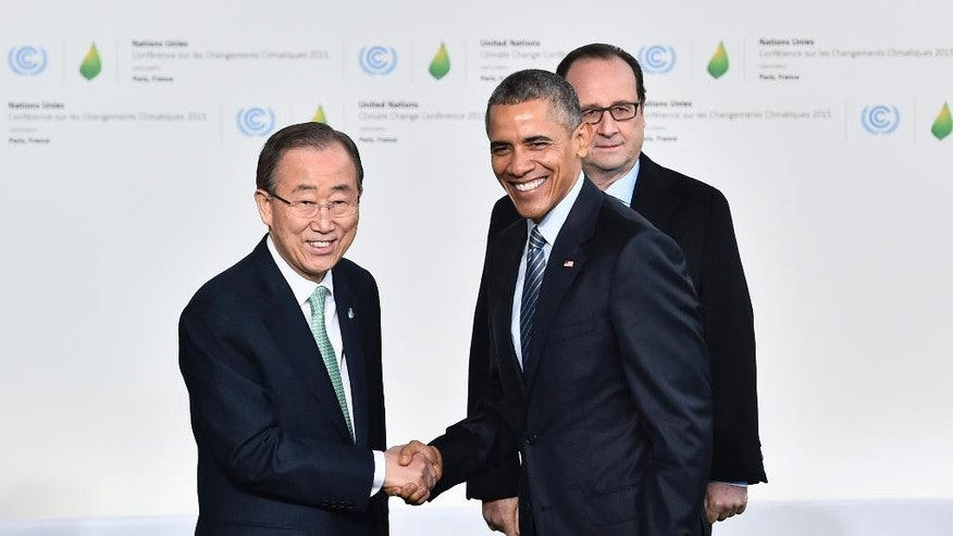 United Nations Secretary General Ban Ki-moon, left, and French President Francois Hollande, right, welcome U.S. President Barack Obama as he arrives for the COP21, United Nations Climate Change Conference, in Le Bourget, outside Paris, Monday, Nov. 30, 2015. (Loic Venance/Pool Photo via AP)